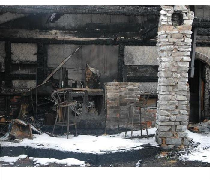 remains of a house after a fire